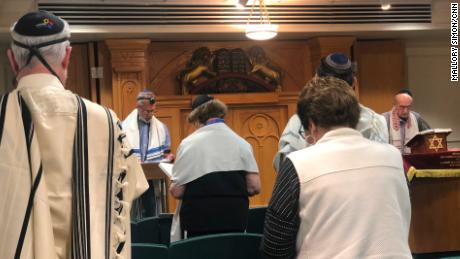 Joe Charny, right, leads a morning service ahead of the anniversary of the massacre at the Tree of Life synagogue.