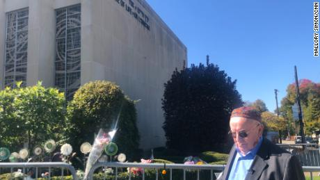 Judah Samet passes by the Tree of Life synagogue, which has been shuttered since the attack.