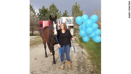 Avery Feinstein with her horse Rudy before she underwent bariatric surgery. Rudy has been by Feinstein's side during her weight loss journey.