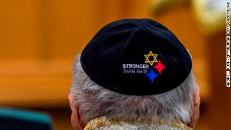 Yarmulkes embroidered with a version of the Pittsburgh Steelers logo are worn at the service.