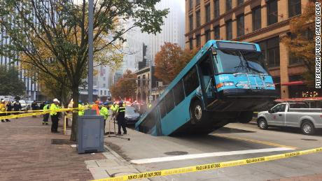 Sinkhole swallows part of Pittsburgh city bus during rush hour