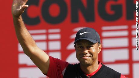 Woods waves after winning his 82nd PGA Tour title Sunday.