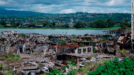 A general view shows destroyed buildings in Marawi on the southern island of Mindanao on May 23, 2019. Two years after the Philippine city of Marawi was overrun by jihadists it remains in ruins, with experts warning that stalled reconstruction efforts are bolstering the appeal of extremist groups in the volatile region.