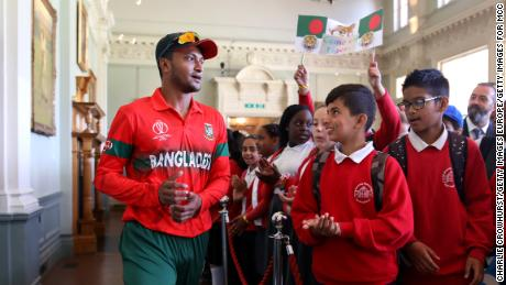 Schoolchildren in the Pavilion at Lord's with Bangladesh's Shakib Al Hasan on July 5, 2019 in London.