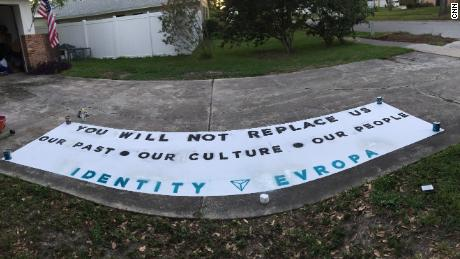 An Identity Evropa banner made on a driveway.