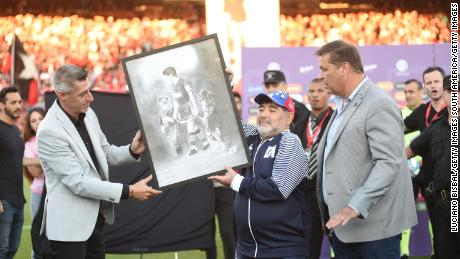 Diego Maradona was presented with painting of himself playing for Newell's.