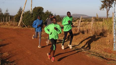 Mary Keitany (left front) trains her husband and coach Charles Koech (right front) in Iten, Kenya.