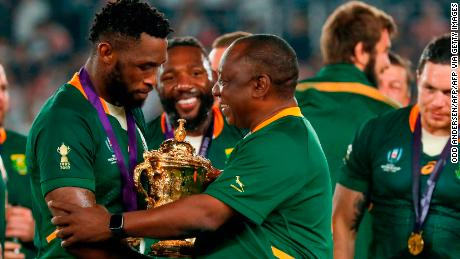 South Africa's President Cyril Ramaphosa congratulates South Africa's captain Siya Kolisi as they celebrate winning the  2019 Rugby World Cup final.