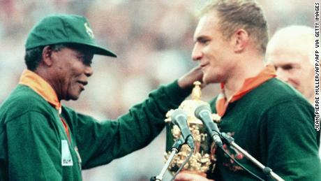 Former South African President Nelson Mandela hands over the Webb Ellis Cup to Springbok skipper François Pienaar in 1995 after his side won the Rugby World Cup and inspired a nation.