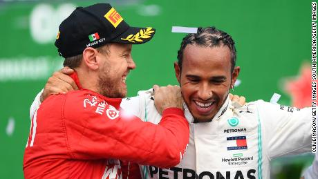 Vettel and Hamilton celebrate on the podium after the Mexican Grand Prix.