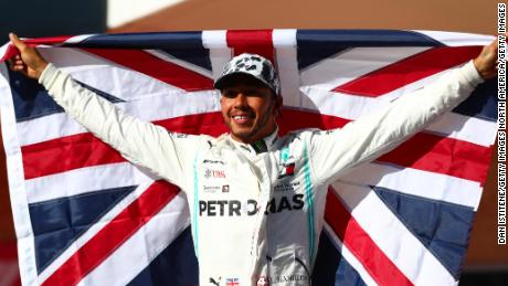 Britain's Lewis Hamilton celebrates in parc ferme after clinching his sixth Formula One world title.