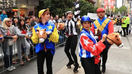 Performers dance during the 2019 Melbourne Cup Parade.