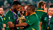 South Africa's President Cyril Ramaphosa (C) congratulates South Africa's flanker Siya Kolisi (L) as they celebrate winning the 2019 Rugby World Cup.