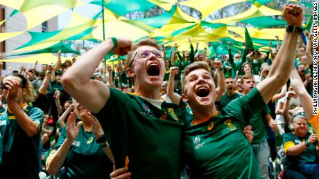 Fans in Pretoria react to a South African try in the Rugby World Cup final.
