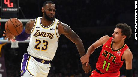 Trae Young #11 of the Atlanta Hawks guards LeBron James #23 of the Los Angeles Lakers during the game at Staples Center on November 11, 2018 in Los Angeles, California.