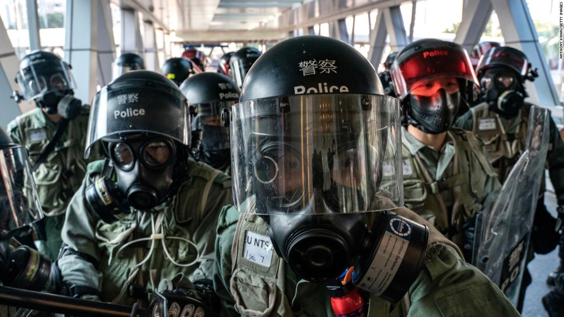 Riot police face off with protesters at an entrance of a shopping mall during a demonstration on November 10.