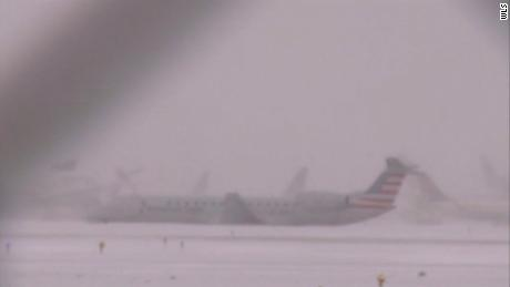 Plane slides off snowy runway at Chicago's O'Hare airport