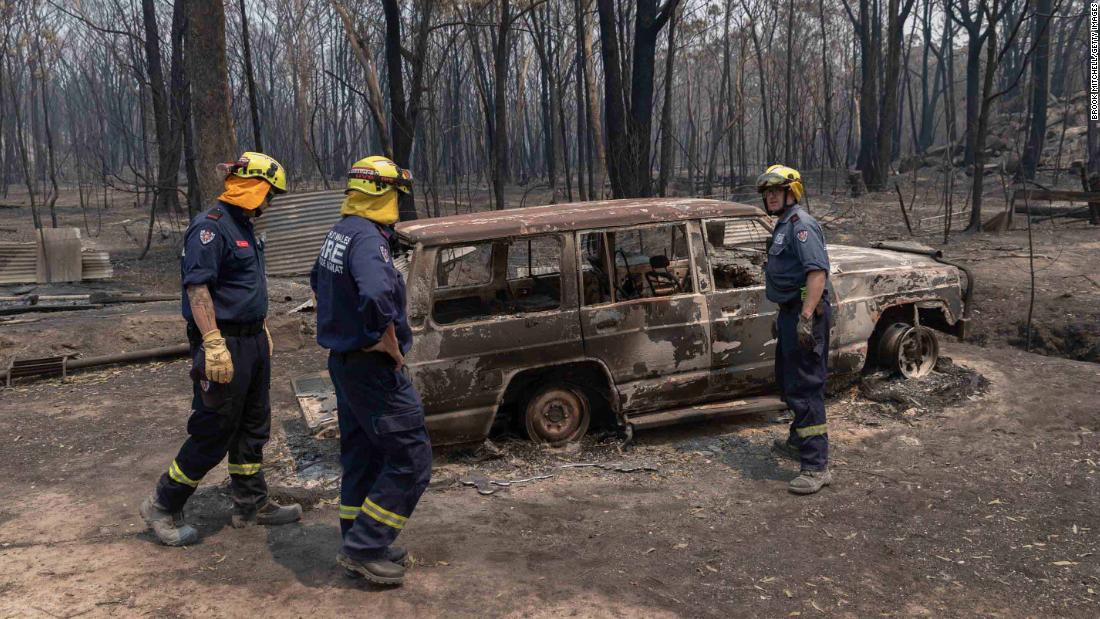 A fire and rescue team inspects damage around the village of Torrington on November 11.