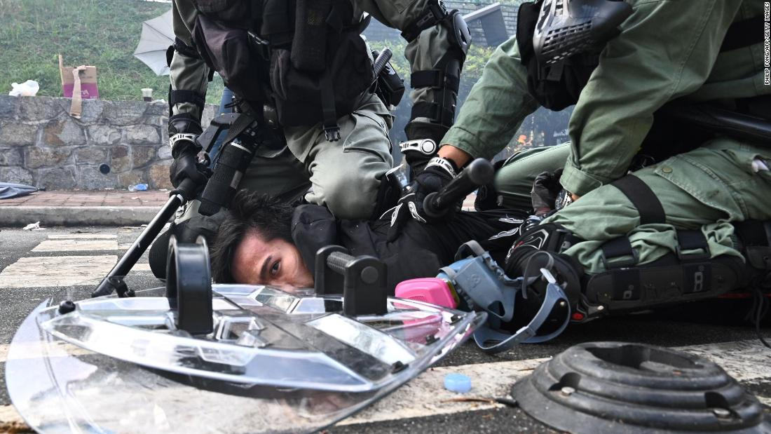 A man is detained during a protest at the Chinese University of Hong Kong on November 12.