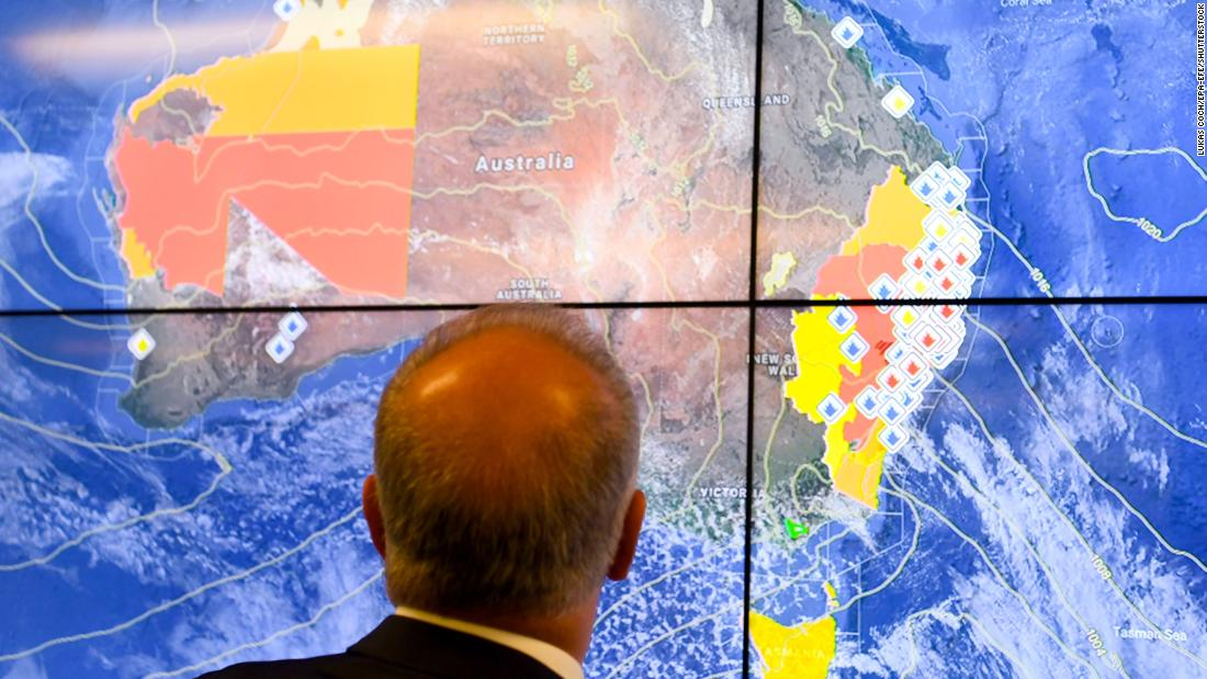 Australian Prime Minister Scott Morrison looks at a screen as he gets a briefing on the bushfire situation on November 12.