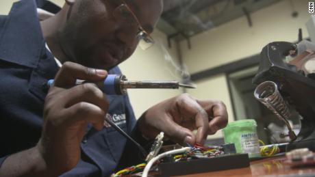 Nicholus Kimali tinkering with a speed governor.