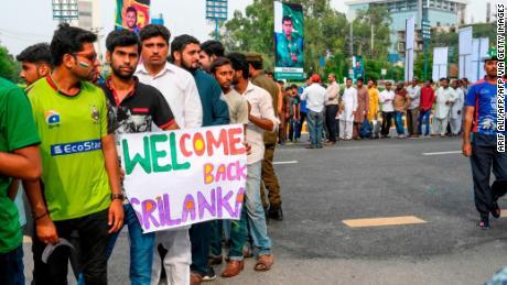 Pakistan cricket fans hold posters welcoming Sri Lanka.