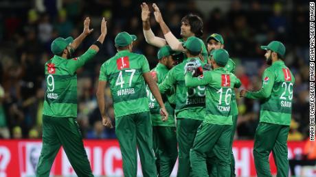 Mohammad Irfan of Pakistan celebrates taking the wicket of Aaron Finch.