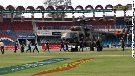Members of the Sri Lankan international cricket team board a rescue helicopter at the Gadaffi Stadium on March 3, 2009 in Lahore, Pakistan.