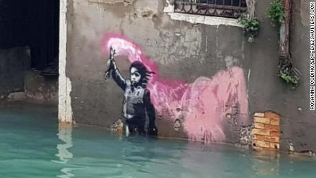 Banksy's Venice artwork of a refugee in a lifejacket is now under floodwater