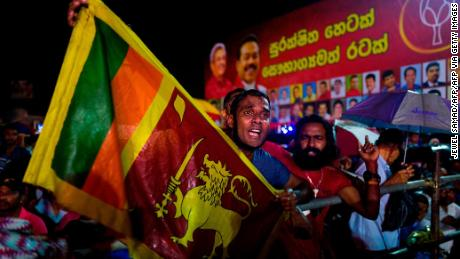 Supporters of Sri Lanka Podujana Peramuna (SLPP) party presidential candidate Gotabhaya Rajapaksa shout slogans during a campaign rally in Homagama on November 13, 2019, ahead of the November 16 presidential election.
