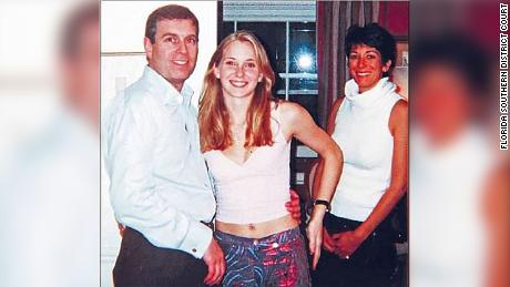 A photograph which appears to show Prince Andrew with Jeffrey Epstein's accuser Virgina Guiffre and alleged madam Ghislaine Maxwell.