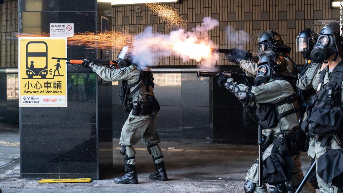 Riot police fire tear gas and rubber bullets as protesters attempt to leave Hong Kong Poytechnic University on November 18.