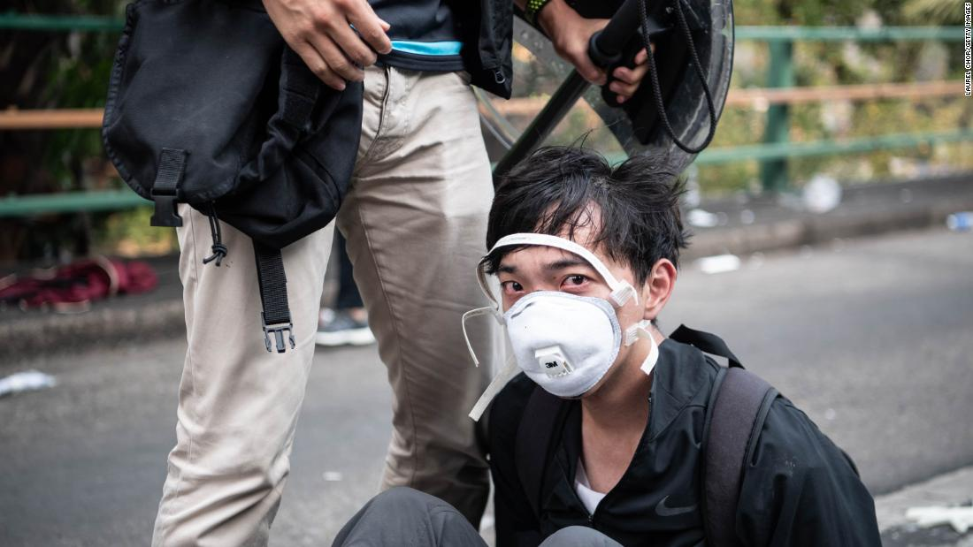 An anti-government protester is detained at Hong Kong Polytechnic University on November 18.