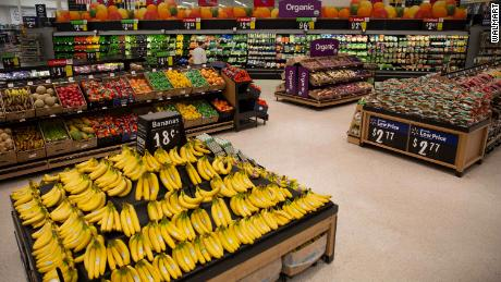 """Walmart is adding new signs, wider aisles and lowering bin heights to create an """"open market feel."""""""