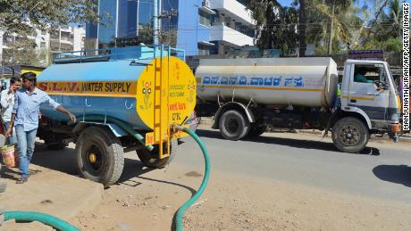 Millions in India's big tech cities depend on private water tankers because government supplies are inadequate. (Manjunath Kiran/AFP/Getty Images)