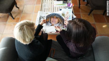 Helene de Ponsay shows a CNN reporter a photo of her murdered sister, Marie-Alice Dibon.
