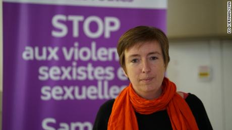 Co-founder Caroline de Haas stands in front of a poster for the group Nous Toutes, who are helping organize large scale protests about femicide and domestic violence around France.
