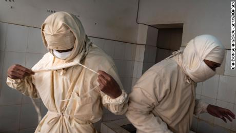 Staff members from a local disease control center wear prevention clothes and masks before entering a plague surveillance lab in Sichuan Province of China in August 28, 2019.