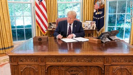 In this White House photo, President Donald Trump signs an executive order on September 19, 2019 to modernize the flu vaccine.