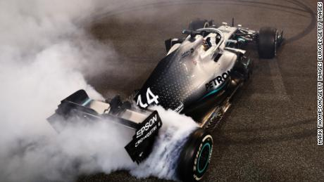 Lewis Hamilton celebrates his win with donuts on track.