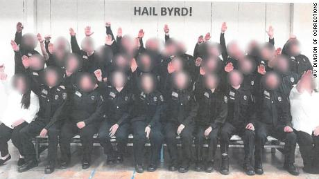 Photo shows West Virginia corrections employees making a Nazi salute