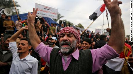 Protesters rally in Baghdad' s Tahrir Square.