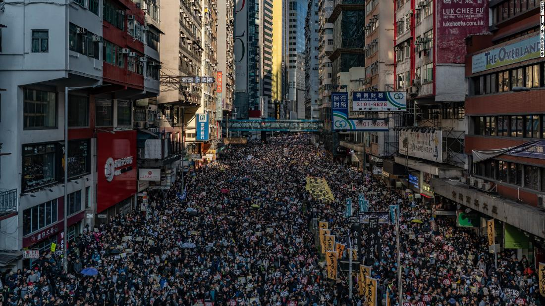 Protesters march in Hong Kong.