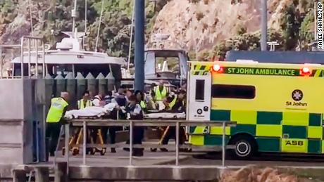 Injured from White Island volcanic eruption are ferried into waiting ambulances in Whakatane, New Zealand, Monday.