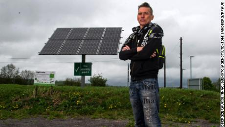 Dale Vince, Chairman of Forest Green Rovers poses next to a solar panel at the New Lawn. The Stadium is completely fulled by renewable energy.