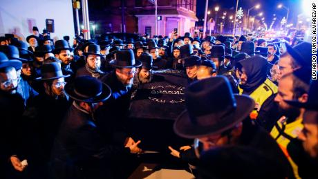Orthodox Jewish men carry the casket with Mindel Ferencz who was killed in a kosher market that was the site of a gun battle.
