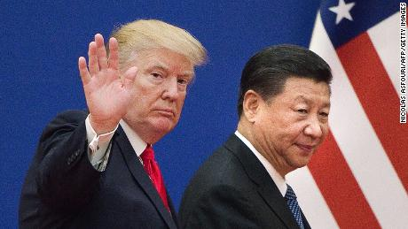 """US President Donald Trump (L) and China's President Xi Jinping leave a business leaders event at the Great Hall of the People in Beijing on November 9, 2017.Donald Trump urged Chinese leader Xi Jinping to work """"hard"""" and act fast to help resolve the North Korean nuclear crisis, during their meeting in Beijing on November 9, warning that """"time is quickly running out"""". / AFP PHOTO / Nicolas ASFOURI        (Photo credit should read NICOLAS ASFOURI/AFP via Getty Images)"""