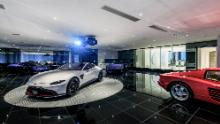 The underground car gallery at this Beverly Hills home can house 7 cars and is adjacent to a lounge.