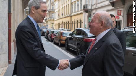 Michael Ignatieff, president and rector of Central European University, greets Ambassador David Cornstein in 2018.