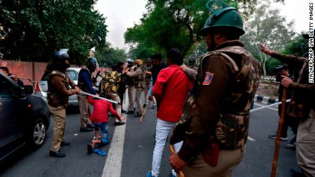 Police clash with demonstrators following a protest against the Indian government's Citizenship Amendment Bill (CAB) in New Delhi on December 15, 2019.